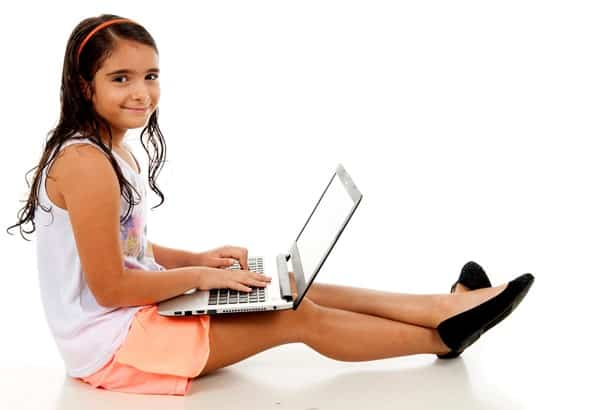 girl doing school work on laptop