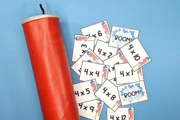 fact fluency game cards shown with storage can decorated to look like dynomite