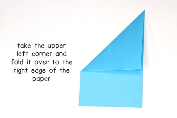 step 3 - fold the upper left corner over to the right edge of the paper